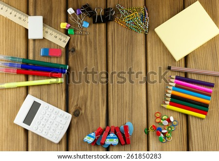 Education concept. Top view of school and office supplies on wooden background with place for your text - stock photo
