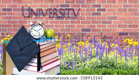 education concept with book and accessory in the front of university - stock photo