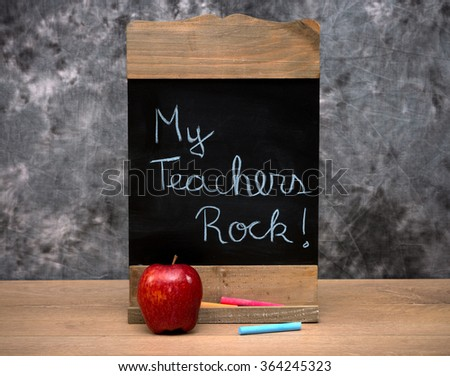 Education concept with text on a wooden chalkboard - stock photo