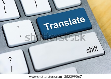 Education concept: Written word Translate on blue keyboard button. - stock photo