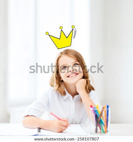 education, creativity, childhood, people and school concept - smiling little school girl drawing and daydreaming at school with crown doodle - stock photo