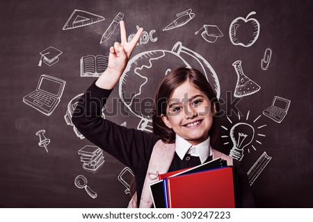 Education doodles against cute pupil smiling at camera holding books - stock photo