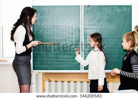 Education. Elementary school student at the blackboard. School concept - stock photo