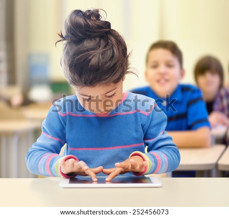 education, elementary school, technology and children concept - little student girl with tablet pc over classroom and classmates background - stock photo