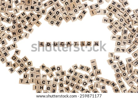 education framed by small wooden cubes with letters isolated on white background - stock photo