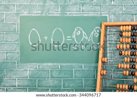 Education funny mathematics idea on sample of addition of eggs - stock photo