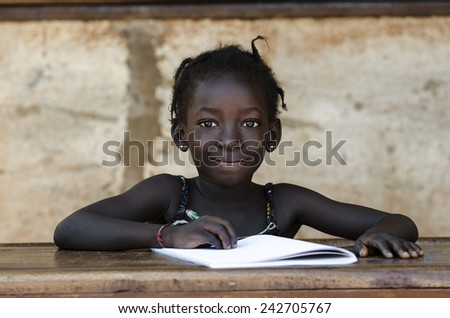 Education: Gorgeous Portrait Of Traditional African School Girl Writing Letter  - stock photo