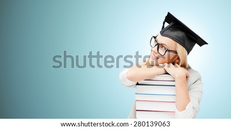 education, happiness, graduation and people concept - picture of happy student in mortar board cap with stack of books daydreaming over blue background - stock photo