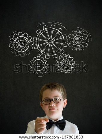 Education needs you thinking boy dressed up as business man with chalk turning gear cogs or gears on blackboard background - stock photo