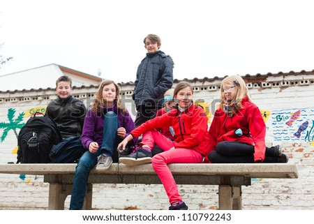 Education - Pupils at schoolyard of their school during recess - stock photo