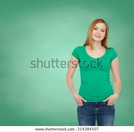 education, school, advertisement and people concept - smiling teenage girl in casual clothes over green board background - stock photo