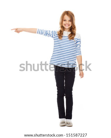 education, school and gesture concept - cute little girl pointing to the side - stock photo