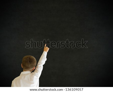 Education school boy hands up answering question on blackboard - stock photo