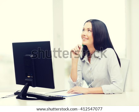 education, school, business and technology concept - smiling businesswoman or student studying - stock photo