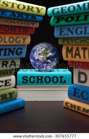 education study books with text learning building knowledge at school, globe is courtesy of NASA, http://visibleearth.nasa.gov/. - stock photo