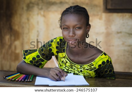 Education Symbol - African Girl Sitting On Her Desk Drawing - stock photo
