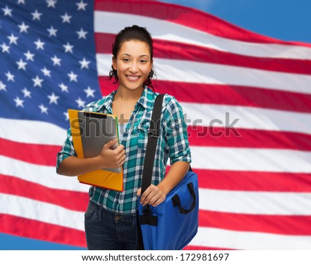 education, technology and people concept - smiling female african american student with folders, bag and tablet pc - stock photo