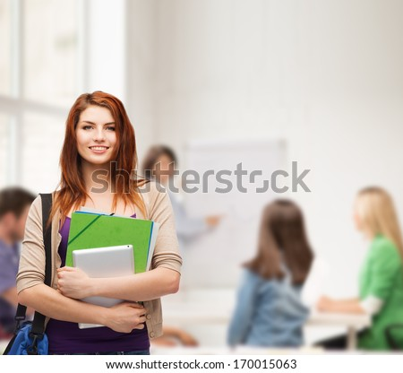 education, technology and people concept - smiling student with bag, folders and tablet pc computer standing - stock photo
