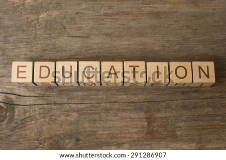 EDUCATION text on a wooden cubes - stock photo