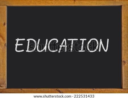 Education written on a blackboard - stock photo