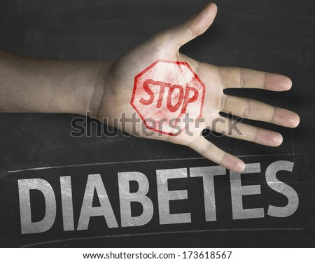 Educational and Creative composition with the message Stop Diabetes on the blackboard - stock photo