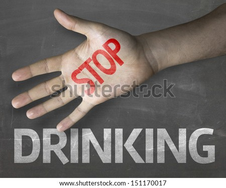 Educational and Creative composition with the message Stop Drinking on the blackboard  - stock photo