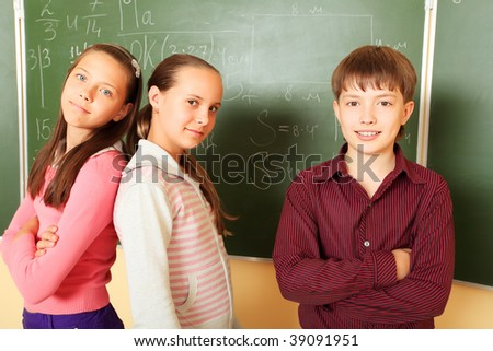 Educational theme:  children in a classroom. - stock photo