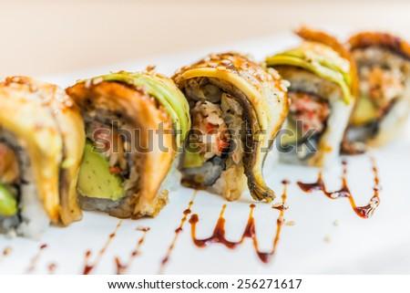 Eel fish sushi roll maki - japanese food - selective focus - stock photo