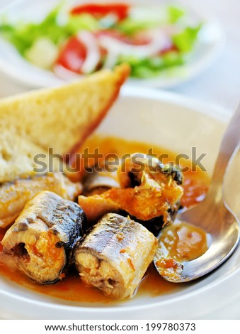 eel stew with tomato and toasted bread - stock photo