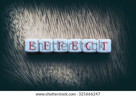 EFFECT word written on white cubes - stock photo