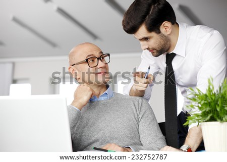 Efficiency business people discussing problems while working at laptop. Teamwork.  - stock photo