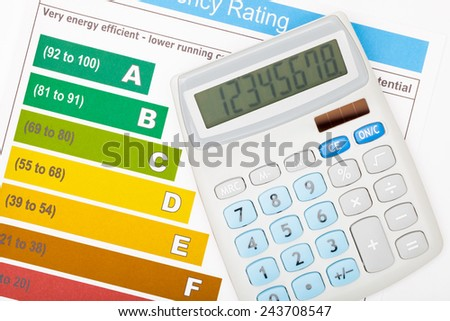 Efficiency chart with calculator over it - stock photo