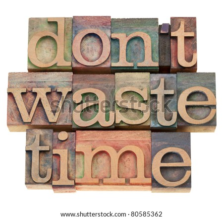 efficiency motivation concept - do not waste time - isolated text in vintage wood printing blocks - stock photo