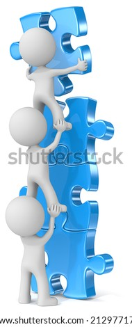 Effort and result. The dude x 3 building blue puzzle tower. - stock photo