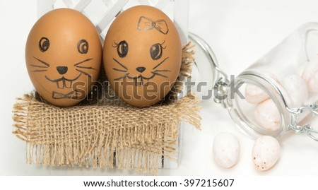 Egg, Easter eggs and candy oval. I draw a bunny on egg shells all. And this is my copyright. - stock photo