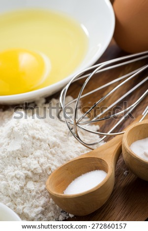 egg, flour and ingredients for baking, vertical, close-up, selective focus - stock photo