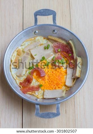 Egg frying pan on wood floor  - stock photo