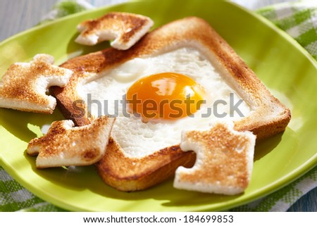 Egg in a hole - stock photo