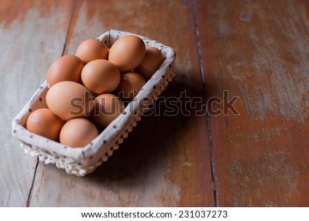 Egg in basket - stock photo