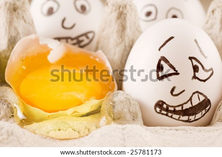 Egg is scared as it sees broken naber in the box - stock photo