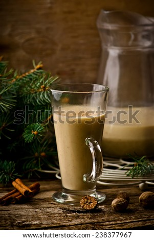 egg nog on a rustic background with a New Year's decor in vintage style. selective focus. - stock photo