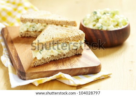 Egg salad sandwich with cucumber, chive and cream cheese - stock photo