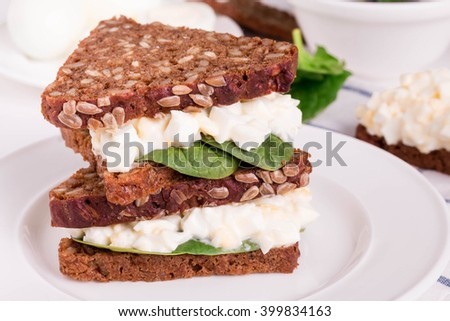 Egg Salad Sandwiches with Whole Grain Bread. Healthy Sandwich for Breakfast.  A delicious low-fat recipe for great sandwiches. - stock photo