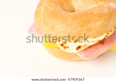 Egg Sandwich / This is a photo of a egg ham and cheese sandwich on a toasted bagel. Shot on a white background. - stock photo