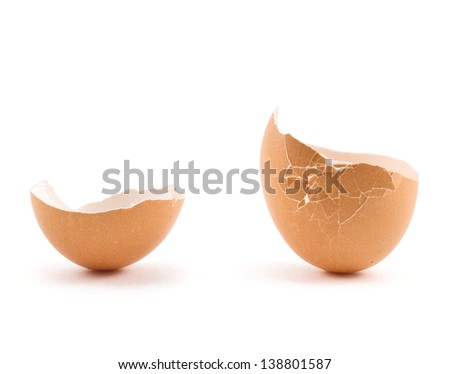 Egg shell cracked and broken in two parts isolated over white background - stock photo