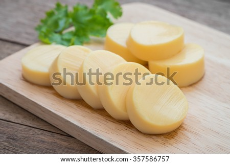 Egg tofu on wooden cutting board  - stock photo