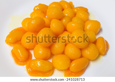 egg yoke fudge balls cooked in syrup (Thong Yot) &  bean-paste (Med Kanoon) - stock photo