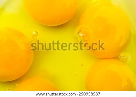 Egg yolk closeup background, isolated - stock photo