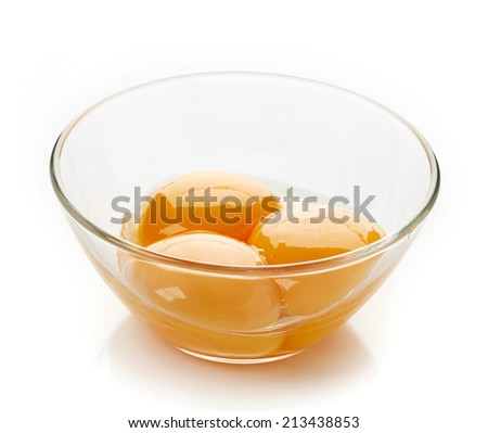 egg yolk in a bowl  isolated on white - stock photo