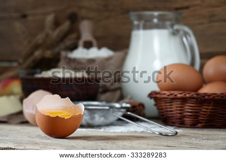 Egg yolk on a wooden table  closeup. Food background - stock photo